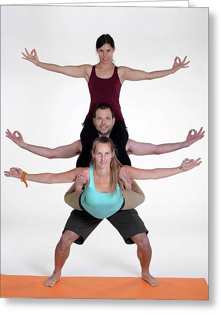 Practicing Acro Yoga Exercises In Group. Greeting Card