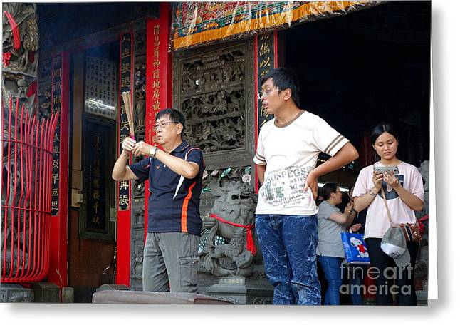 Greeting Card featuring the photograph Praying At A Temple In Taiwan by Yali Shi