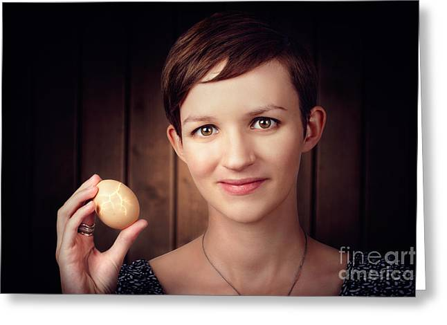 Pretty Young Brunette Woman Holding Hatching Egg Greeting Card