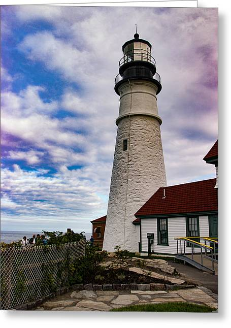 Puffy White Clouds Above Portland Lighthouse Greeting Card by Jeff Folger