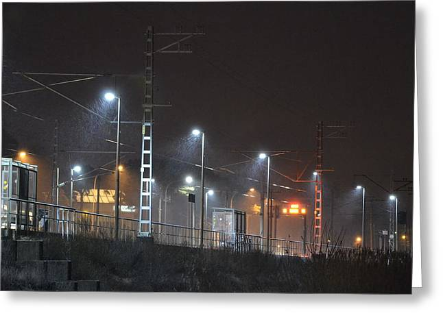 Railway Station In Snowy Winter Evening Greeting Card by Uldis Cakans