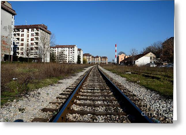 Railway Tracks Weathered Apartment Buildings And Red Industrial Chimney Belgrade Serbia Greeting Card by Imran Ahmed
