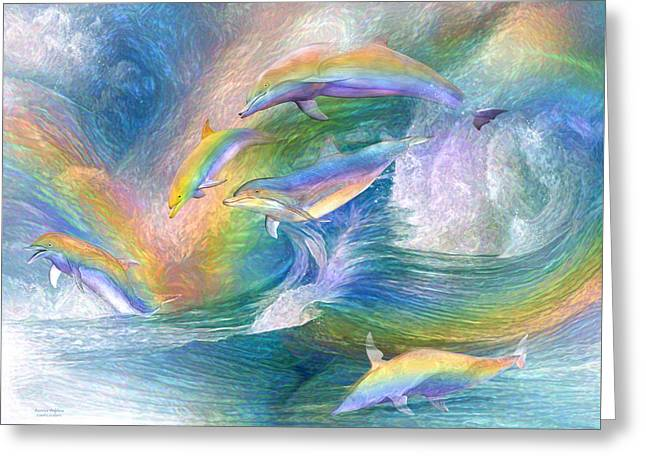 Rainbow Dolphins Greeting Card by Carol Cavalaris