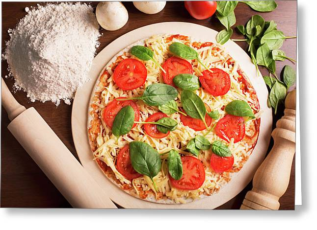 Raw Italian Pizza With Tomato And Spinach Greeting Card by Vadim Goodwill