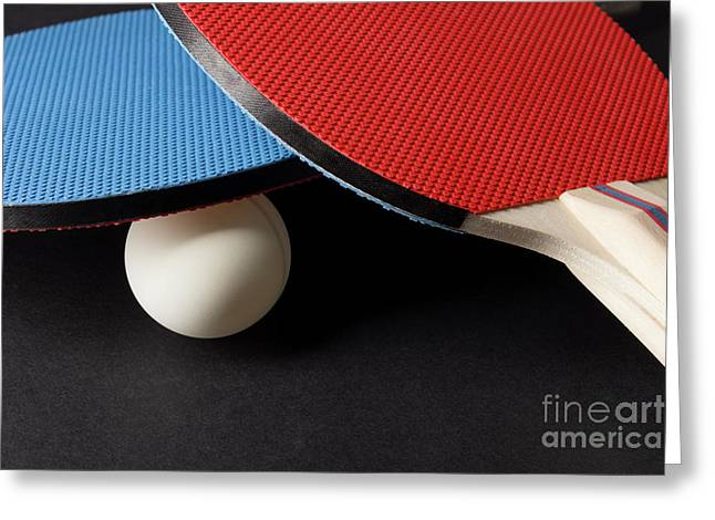 Red And Blue Ping Pong Paddles - Closeup On Black Greeting Card