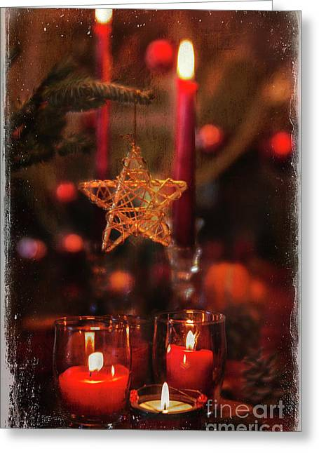 Greeting Card featuring the photograph Red Candles  by Elena Nosyreva