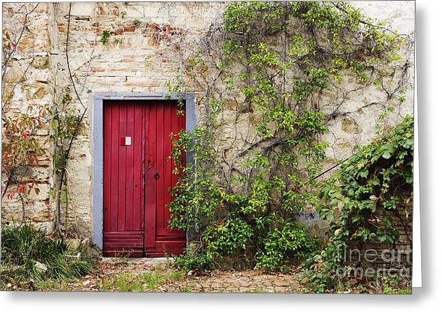 Red Door In Old Brick And Stone Cottage Greeting Card by Jeremy Woodhouse
