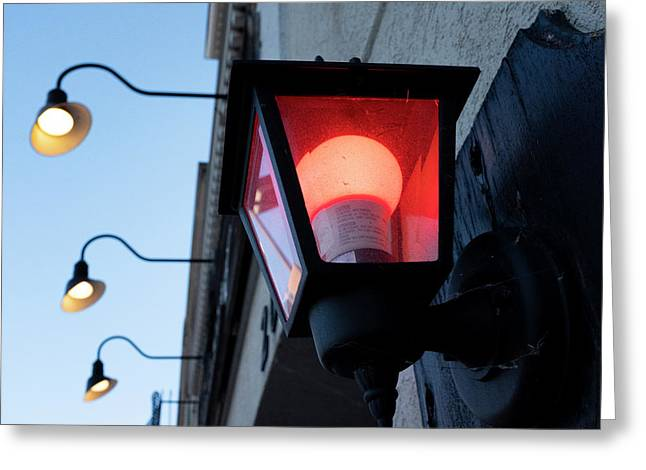 Red Light On The Wall With A Blue Sky And Yellow Bulbs In Holland Michigan Greeting Card