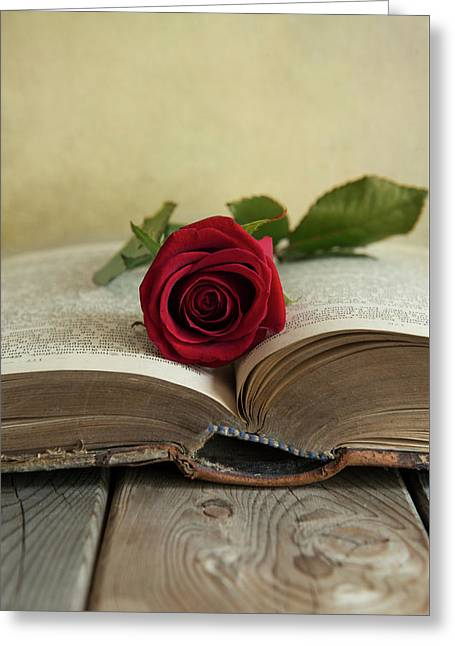 Red Rose On An Old Big Book Greeting Card by Jaroslaw Blaminsky