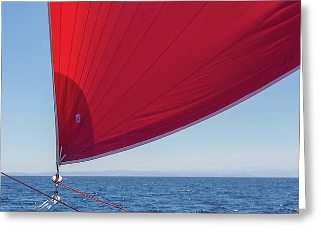 Greeting Card featuring the photograph Red Sail On A Catamaran 2 by Clare Bambers