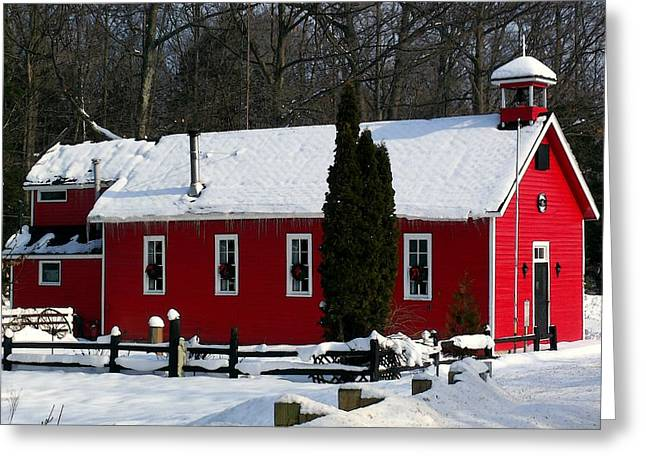 Red Schoolhouse At Christmas Greeting Card by Desiree Paquette
