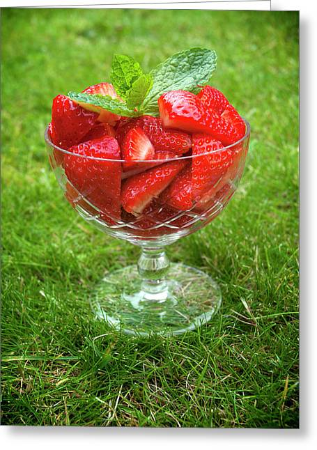 Red Strawberries In A Glass Bowl On Green Grass Greeting Card by Anita Van Den Broek