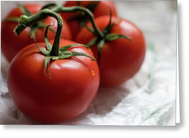 Red Tomatoes On The Vine Greeting Card by Terry DeLuco