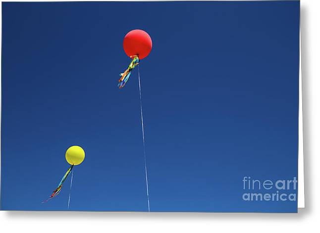 Greeting Card featuring the photograph Red,yellow Balloon Blowing By The Wind In The Air With The Blue  by Jingjits Photography