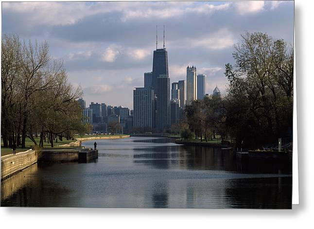 Reflection Of Buildings In A Lagoon Greeting Card by Panoramic Images