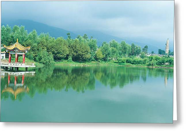 Reflection Of Pagoda Pavilion In Dali Greeting Card by Panoramic Images