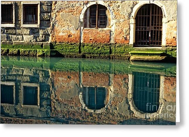 Reflection On Canal In Venice Greeting Card by Michael Henderson