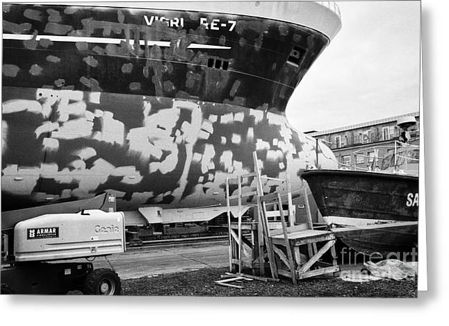 Repairing And Painting Hull Of A Ship In Dry Dock In Reykjavik Harbour Iceland Greeting Card