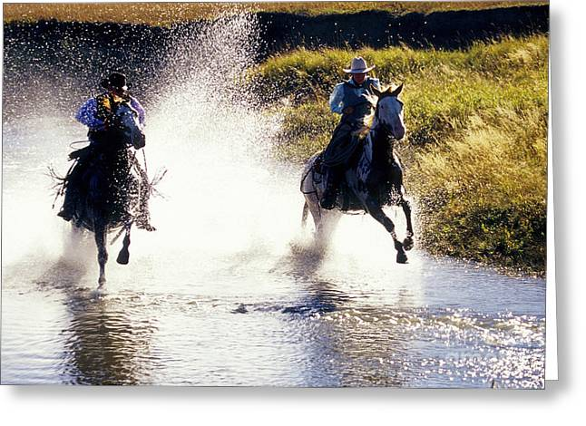 Riders In A Creek Greeting Card by Inga Spence