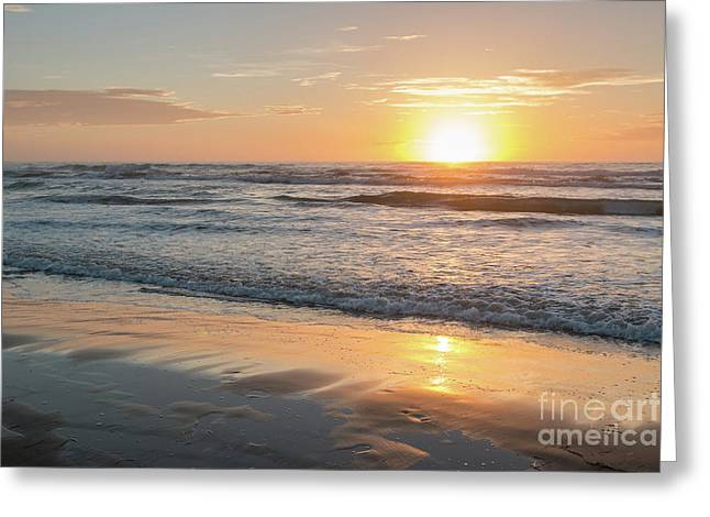 Rising Sun Reflecting On Wet Sand With Calm Ocean Waves In The B Greeting Card