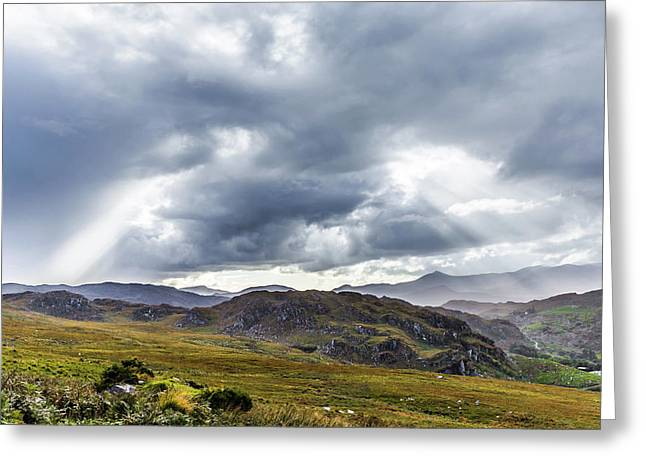 Greeting Card featuring the photograph Rock Formation Landscape With Clouds And Sun Rays In Ireland by Semmick Photo