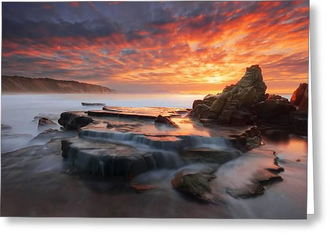 rock in Azkorri beach at sunset Greeting Card by Mikel Martinez de Osaba