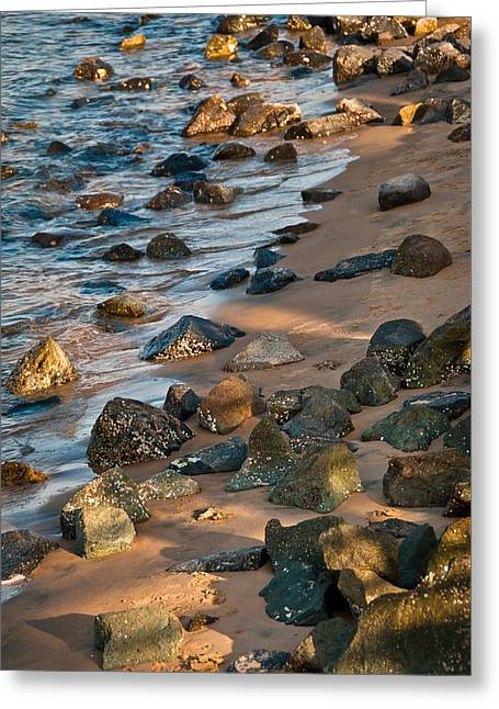 Harmony In Nature - Rocks, Pebbles, And Waves On Sandy Beach Greeting Card by Aaron Sheinbein
