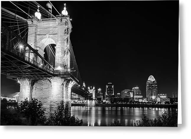 Greeting Card featuring the photograph Roebling Bridge And Cincinnati Skyline At Night - Black And White by Gregory Ballos