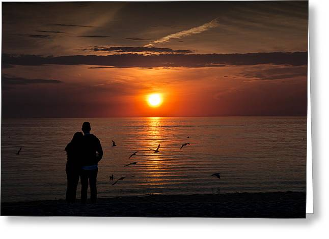 Romantic Couple Watching The Days Last Light Greeting Card by Randall Nyhof