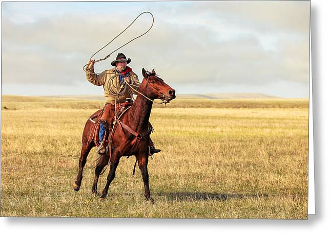 Roping On The High Plains Greeting Card by Todd Klassy