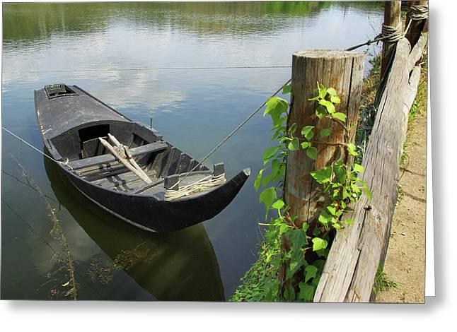 Row Boat On The Shoreline Greeting Card by Carlos Caetano