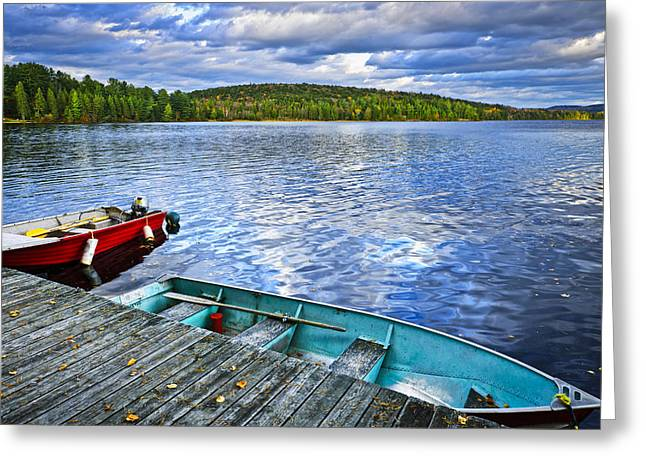 Autumn Landscape Photographs Greeting Cards - Rowboats on lake at dusk Greeting Card by Elena Elisseeva