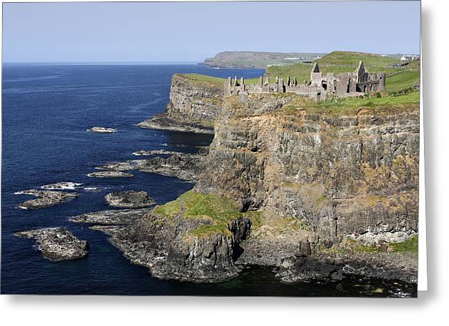 Ruins Of Dunluce Castle On The Sea Cliffs Of Northern Ireland Greeting Card by Pierre Leclerc Photography