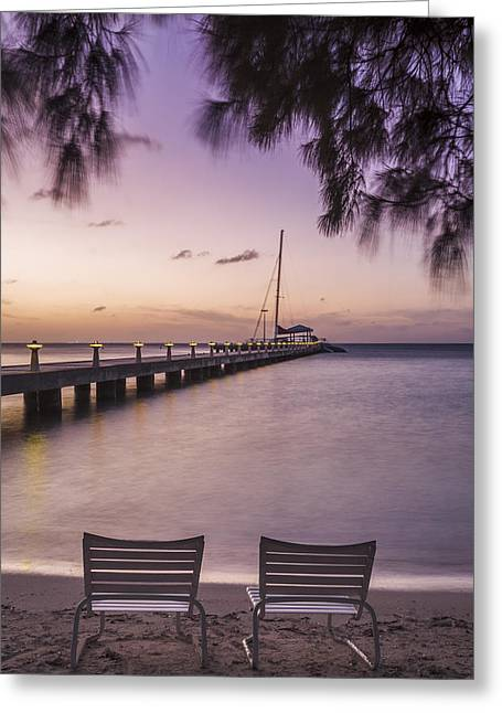 Rum Point Beach Chairs At Dusk Greeting Card by Adam Romanowicz