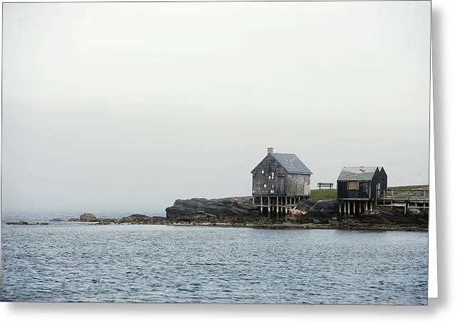 Rustic Cabin On Stilts On Rocky Shore Greeting Card by Gillham Studios