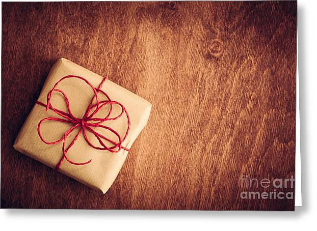 Rustic Retro Gift, Present Box With Red Ribbon. Christmas Time Greeting Card