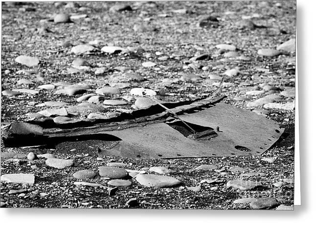 Rusty Car Undertray Left On Stony Pebble Beach In Iceland Greeting Card by Joe Fox