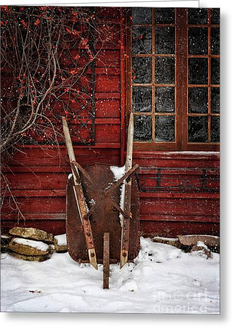 Rusty Wheelbarrow Leaning Against Barn In Winter Greeting Card