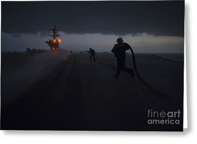 Sailors Run To Install Slot Seals In A Catapult Track After Launching Aircraft. Greeting Card by Celestial Images