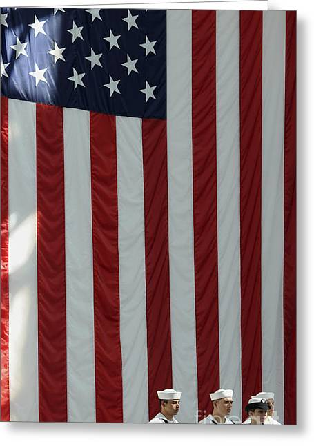 United We Stand Greeting Cards - Sailors Stand In Front Of The American Greeting Card by Stocktrek Images