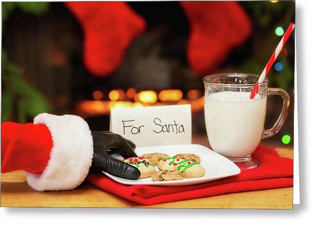 Santa Grabbing Christmas Cookies Greeting Card by Susan Schmitz