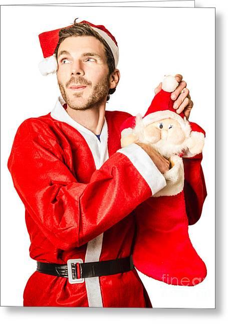 Santa Stocking Up On Christmas Gifts Greeting Card