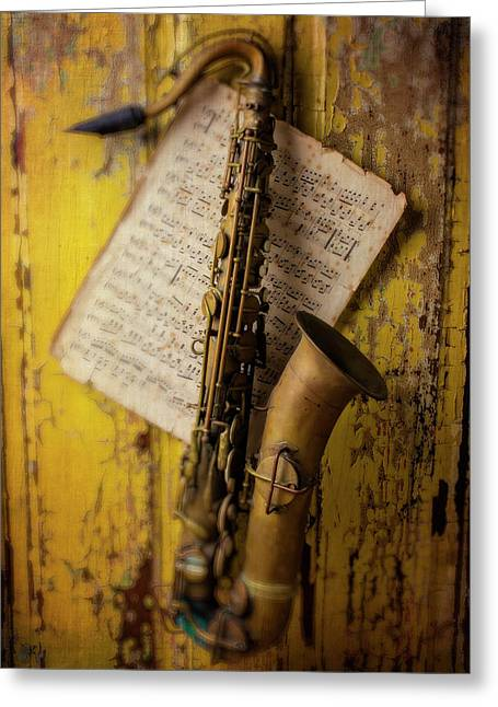 Saxophone Hanging On Old Wall Greeting Card