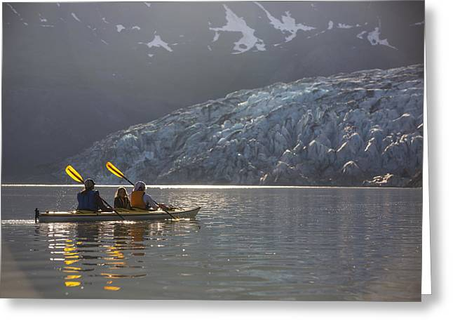 Sea Kayakers Paddling In Evening Light Greeting Card