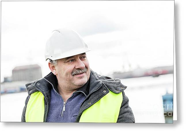 Senior Engineer Builder At The Construction Site. Greeting Card