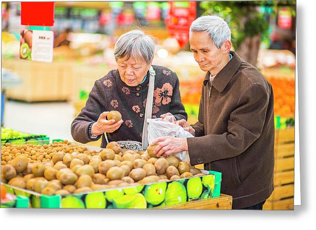 Senior Man And Woman Shopping Fruit Greeting Card