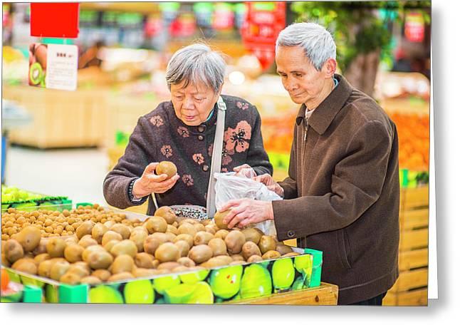 Senior Man And Woman Shopping Fruit Greeting Card