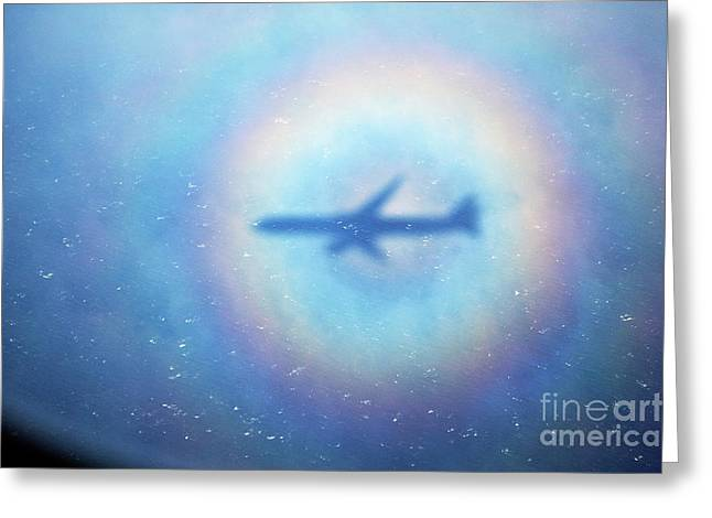 Shadow Of An Aeroplane Surrounded By A Rainbow Halo Greeting Card by Sami Sarkis
