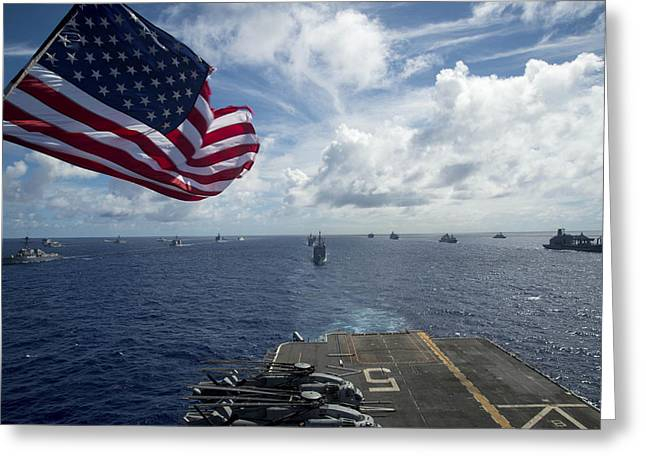 Ships Gather In Formation Aft Of The Amphibious Assault Ship Uss Peleliu  Greeting Card by Celestial Images