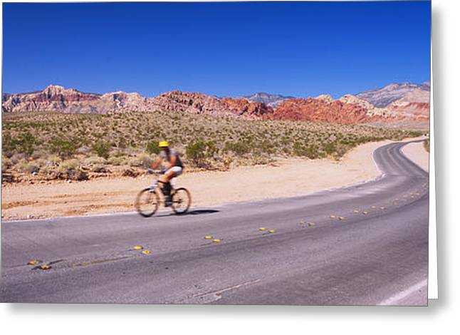 Side Profile Of A Person Cycling Greeting Card by Panoramic Images